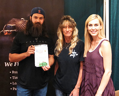 Jep Robertson & wife Jessica From TV show ``Duck Dynasty` with their new Block Sharpener