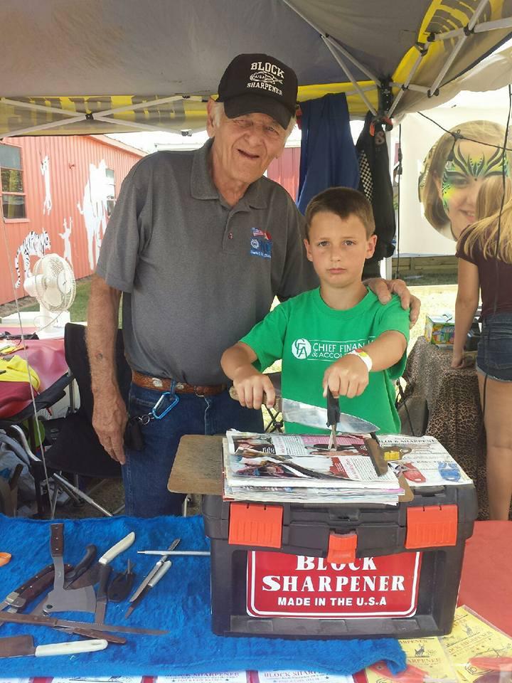 Grand pa Block teaches grandson Justin the Business Imlay city fair 7-29-16