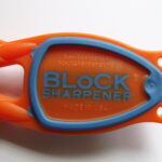 orange handle blue grip Block Sharpener