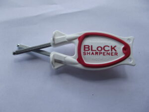 white handle with red grip Block Sharpener