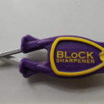 Block knife Sharpener with purple handle and yellow grip