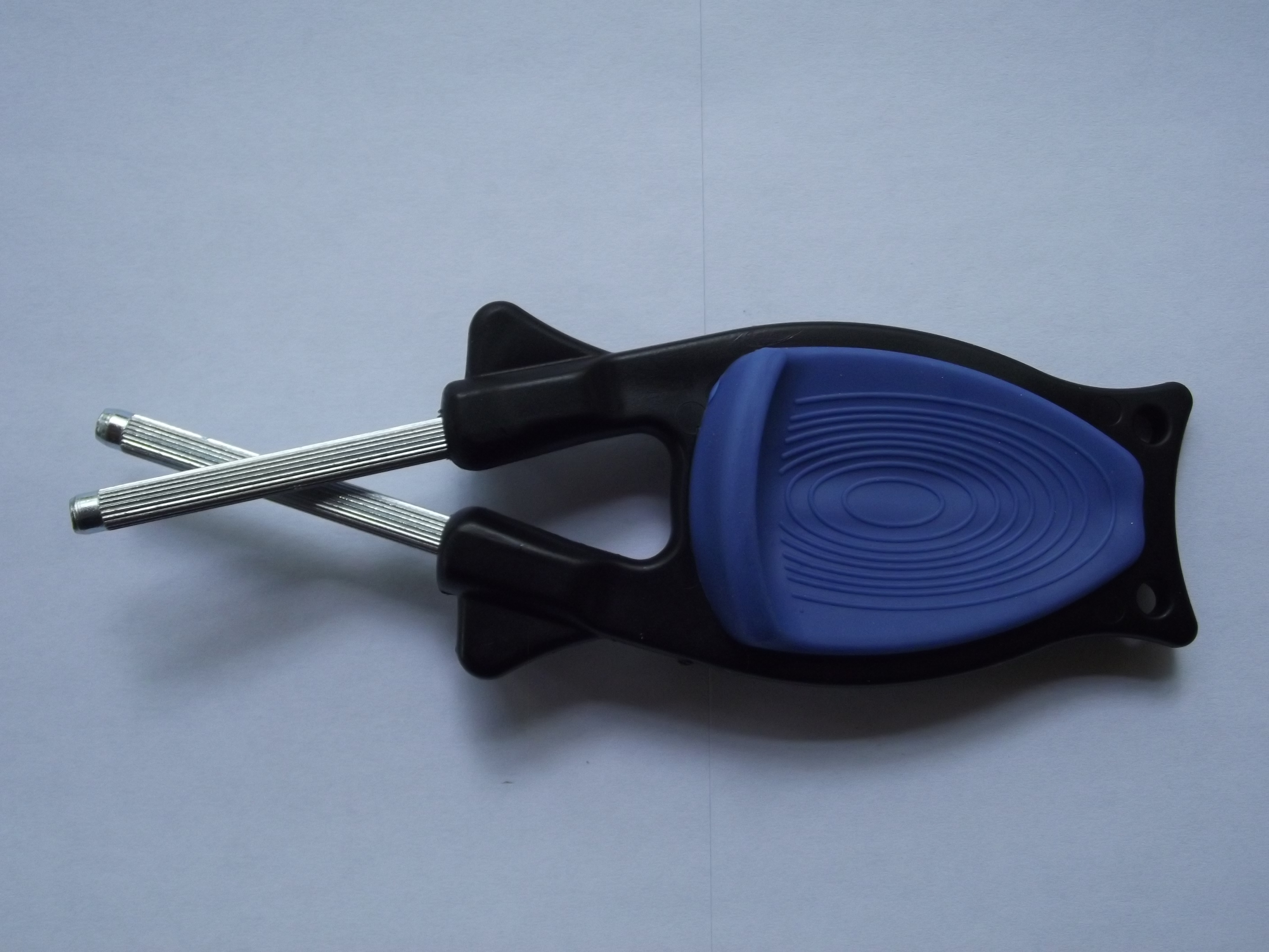 Block sharpener with a black handle and blue grip