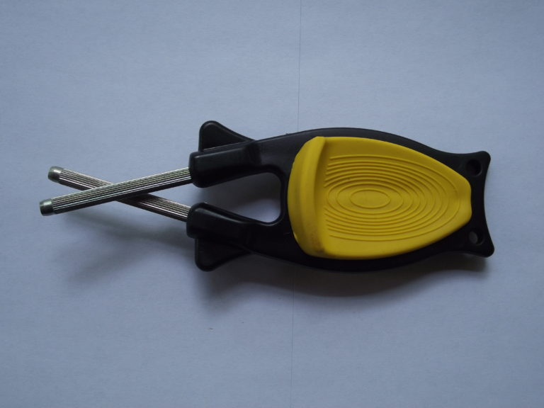 block sharpener with black handle and yellow grip grip