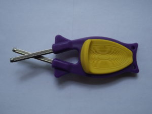 block sharpener with purple handle and yellow grip