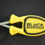 Yellow knife sharpener with Black grip