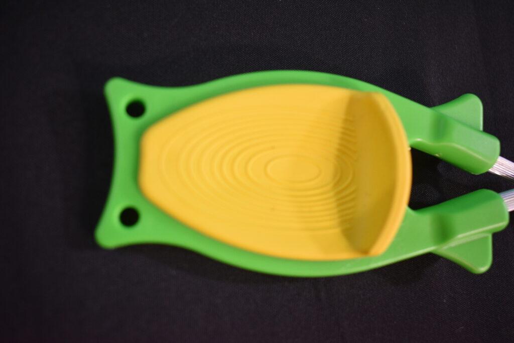 Yellow thumb grip on a Block knife sharpener